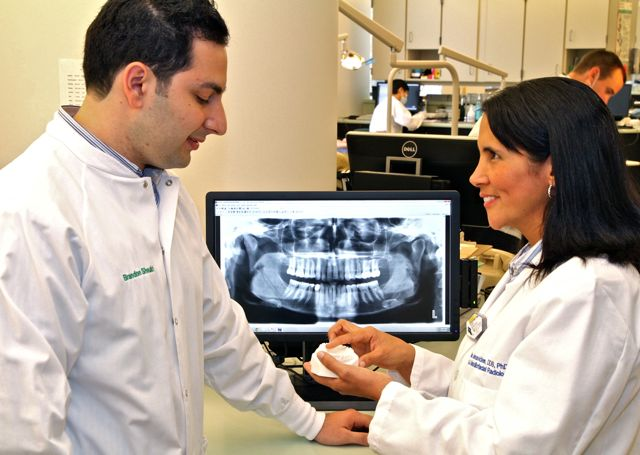 Two dentists working with a computer